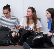 Three students at Lender Center symposium.
